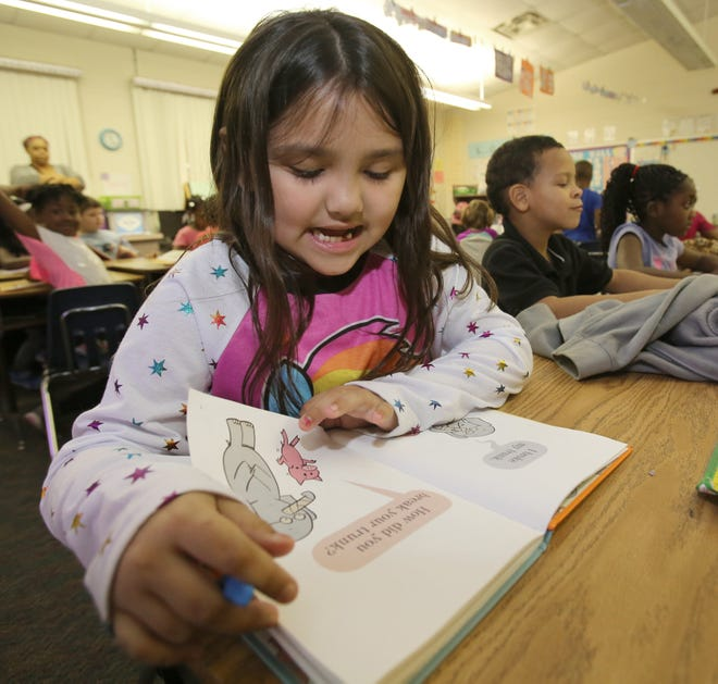 """Amari Romo, 7, reads a books after a """"whole brain teaching"""" lesson in Daphne Butler's first-grade class in 2016 at Evergreen Elementary School on Northwest Anthony Road in Ocala. Schools around Florida are scrambling to help students who have fallen behind as testing time approaches."""