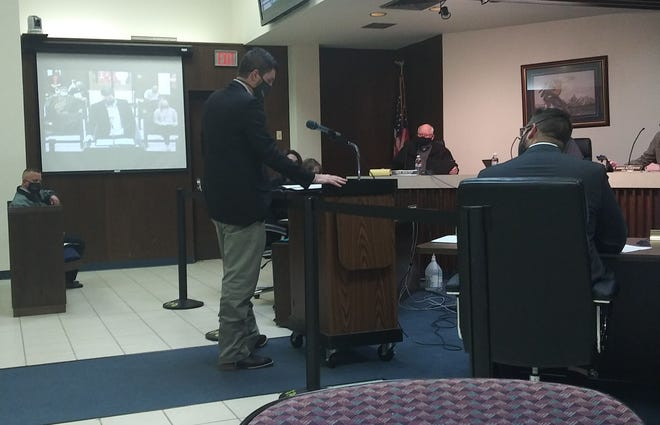 Shawnee City Engineer Seth Barkhimer stands before Shawnee City Commissioners in January as he explains an agenda item seeking to negotiate a contract with a firm for design services on the 45th Street transportation project.