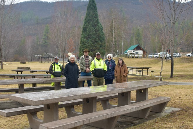Members of the Yreka Rotary and the City of Yreka pose for a photo in front of the new park benches.