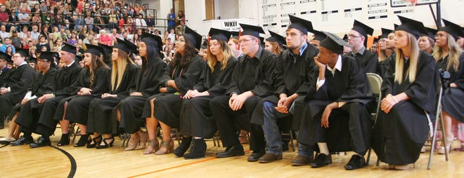 Soon-to-be graduates of Kewanee High School listen to a speaker at 2018 commencement activities.