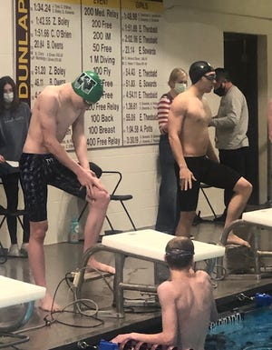 Wethersfield's Colton Mosley and Kewanee's Connor Bryan prepare for their race in the 50-yard freestyle at Dunlap High School on Tuesday. Mosley won by 0.55 of a second.