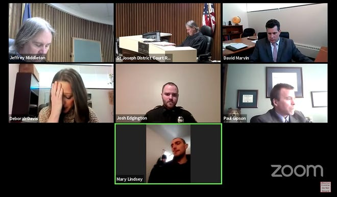 Attorney Deborah Davis, left center, reacts during a livestream court proceeding March 2, after it was confirmed the defendant in an assault case was at the same house as the alleged victim, during the live hearing. Davis made her suspicion known to the court during the preliminary examination, after noting the witness' body language.