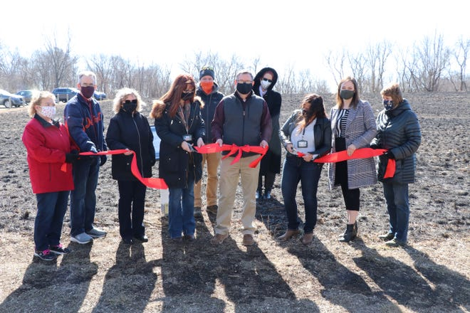 Representatives from Sturgis District Library, sponsorship organizations and St. Joseph County were present Friday for the StoryWalk ribbon-cutting ceremony at Plumb Lake County Park.
