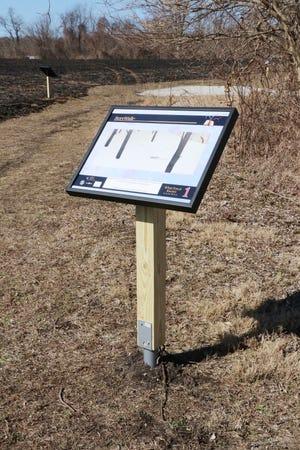A StoryWalk sign at Plumb Lake County Park.