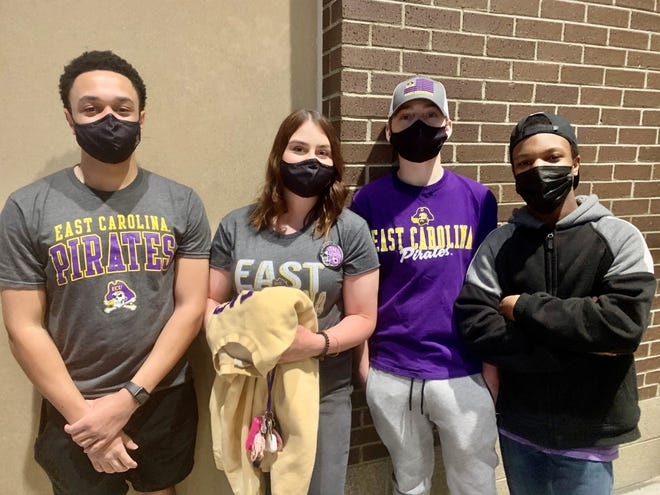 From left to right: East Carolina freshmen Devin Armstrong, Abigail Bringle, Noah Walker and Jahiem Hill were among the first in line for tickets for Thursday night's men's basketball game against UCF. The game was open first-come, first-serve, for up to 700 students.
