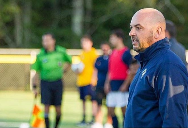 Henry Almeida celebrated his 100th career win at UMass Dartmouth in 2019.