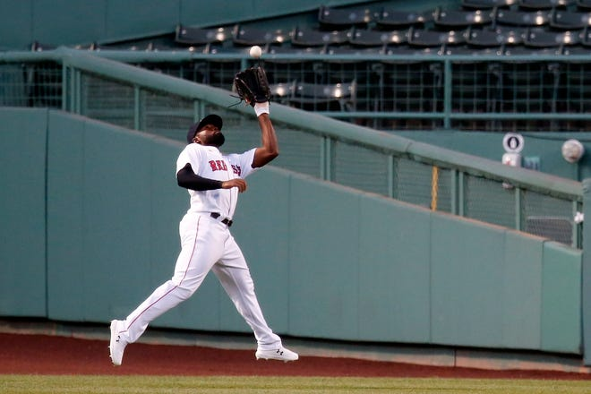Boston Red Sox's Jackie Bradley Jr. was traded to the Milwaukee Brewers.