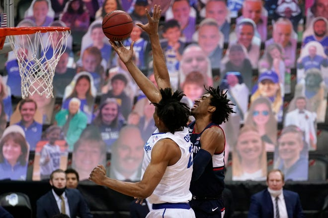 UConn forward Isaiah Whaley (5) goes up for shot against Seton Hall center Ike Obiagu (21) during the Huskies' win  in Newark, N.J.