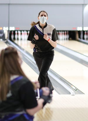 Washburn Rural senior Hannah Casto reacts after bowling a strike during the Class 6A State Bowling Tournament on March 5 at Northrock Lanes in Wichita.