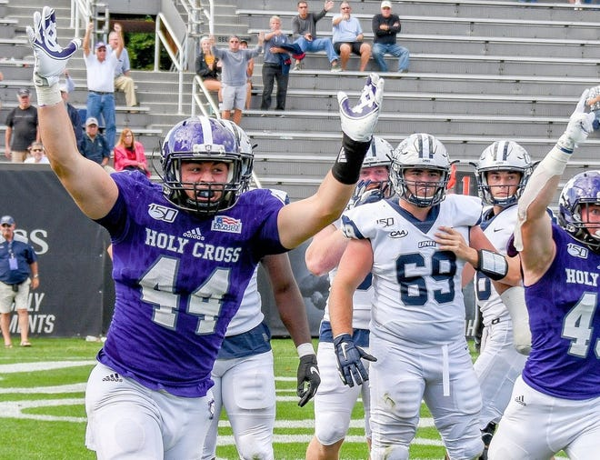Holy Cross linebacker Liam Doran celebrates as the Crusaders defeated New Hampshire during the 2019 season.