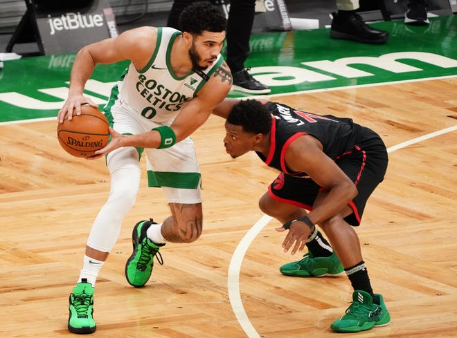 Celtics forward Jayson Tatum works the ball against Raptors guard Kyle Lowry during the third quarter of Thursday night's victory.