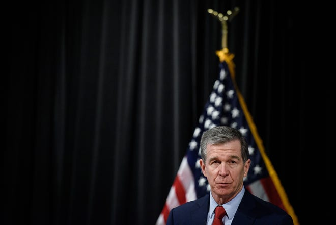 N.C. Governor Roy Cooper tours a Cumberland County COVID-19 drive thru vaccination site at the Crown Expo Center in Fayetteville, Friday, March 5, 2021.