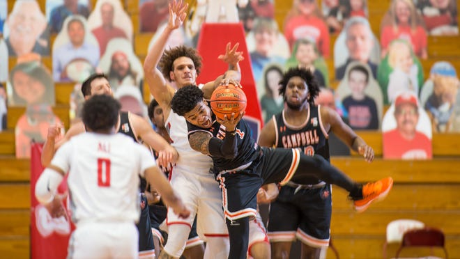 Campbell's Ricky Clemons gets control of the ball during Thursday's Big South semifinal win at Radford.