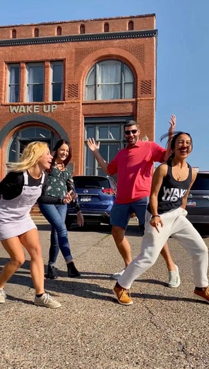Paige Schemenauer (front left), Meridyth Moose (back left), Matt Smith (back right) and Mia Gilbertson (front right) are the minds behind the marketing company Smith started with Louis Curtis.