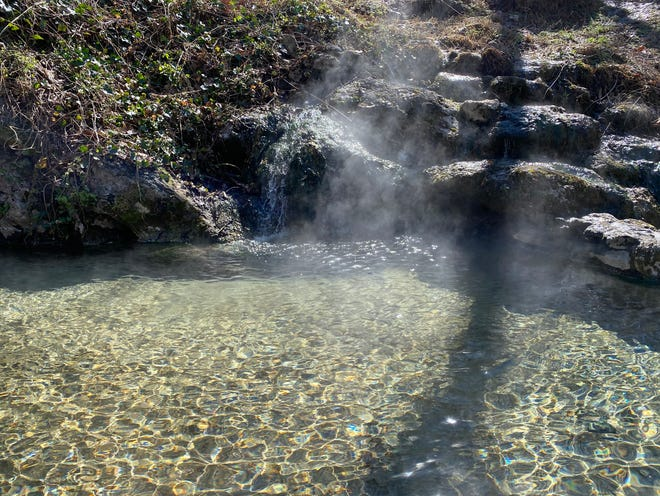 Steam rises off one of the many springs that made Hot Springs, Ark., famous.
