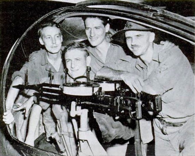 """Dale Bordner served as mayor of Grandview Heights from 1971 to 1974. He is shown at the left with his crew mates in the gun blister of an Australian seaplane that rescued them after their World War II Martin B-26 Marauder bomber was shot down. The B-26 often was referred to as the """"widowmaker"""" because of the number of crashes that the aircraft was involved in."""