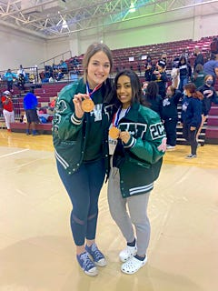 Waxahachie powerlifters Lexi Chandler (left) and Beatriz Garcia show their medals from the region girls' powerlifting meet at Whitehouse High School. The two qualified for the state championship meet in Corpus Christi.