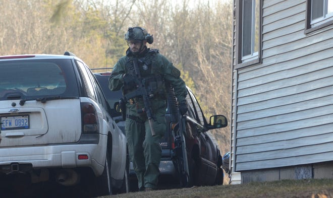 Calhoun County Sheriff Department deputies executed a search warrant Thursday at a home on Waubason Road as part of an armed robbery investigation from 2020. (Trace Christenson/The Enquirer)