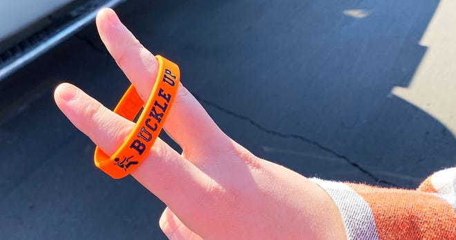 The Galion FCCLA  chapter and School Resource Officer Ralph Burwell teamed up to distribute bracelets reminding students to buckle up.