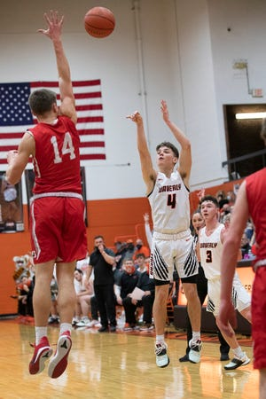 Waverly junior Trey Robertson shoots a three pointer during the second quarter of Waverly's game against Sheridan on Thursday, March 4, 2021 in Waverly, Ohio. Robertson would total 34 points for the night to help defeat Sheridan 61-45.