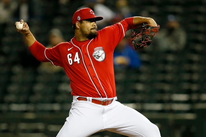 Cincinnati Reds pitcher Tony Santillan (64) throws a pitch in the eighth inning of the MLB Cactus League Spring Training game between the Cincinnati Reds and the Kansas City Royals at Goodyear Ballpark in Goodyear, Ariz., on Thursday, March 4, 2021. The Royals won 5-3 in a nine-inning game.