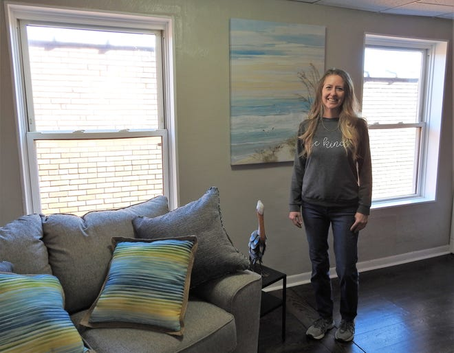 Amy Hasseman in the beach-themed room of the Renaissance on Main at 534 Main St. The building will have 12 Airbnb units and two apartments. There are also four store fronts on the ground floor with one currently open.