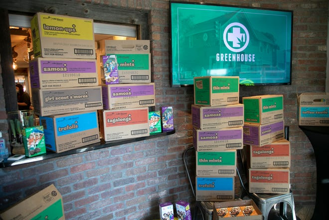 Greenhouse of Walled Lake owner Jerry Millen buys 301 boxes of Girl Scout cookies from Jennifer Slayden, 39, of Oakland County on Mar. 5, 2021, after Slayden, a mother of two Girl Scouts, was disappointed about her daughter's lack of opportunity to sell more Girl Scout Cookies after the Girl Scouts of the USA are forbidding the Oakland County Girls Scouts to sell their cookies in front of the Marijuana dispensary Greenhouse of Walled Lake after they had gangbuster sales last weekend.