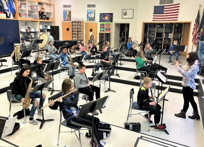Lena band teacher Lisa Pollman conducts a middle school class.