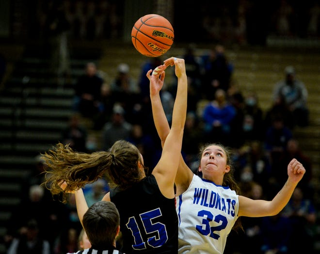 Havre's Loy Waid and Columbia Falls' Madysen Hoerner compete to win the opening jump ball at the start of Thursday's semifinal game during the Class A State Basketball Tournament at the Four Seasons Arena in Great Falls.