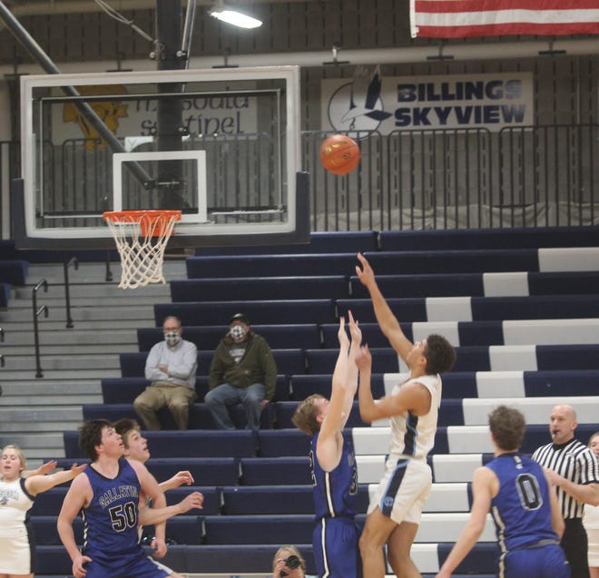 Great Falls High's Reed Harris, in white, shoots over Gallatin's Tyler Nansel during their Eastern AA Playoff game Thursday at Bill Swarthout Fieldhouse.