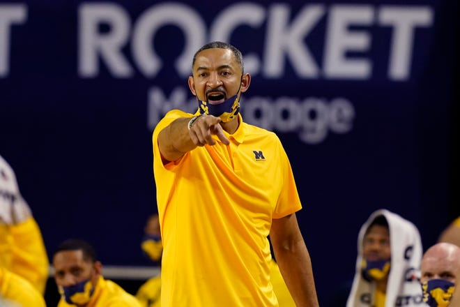 Michigan head coach Juwan Howard directs from the sideline during the first half of an NCAA college basketball game against Michigan State, Thursday, March 4, 2021, in Ann Arbor, Mich. (AP Photo/Carlos Osorio)