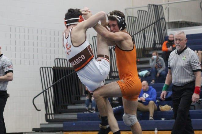 Ashland's Jayden Jones takes Buckeye's Preston DiMarco to the ground during their 145-pound match Thursday at Norwalk High School.