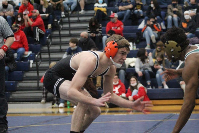 Ashland's Case George competes in a 120-pound match Thursday at the Div. II Norwalk District.