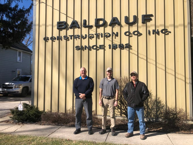Jeff Baldauf (left) recently sold Baldauf Construction to Brian Kurtz (middle) and Mike Brown marking the first time in nearly 140 years that Baldauf Construction isn't owned by a family member.