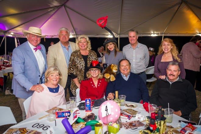 Standing: Garrett Smith, Kevin Dohm, Dianna Dohm, Jean Grela, Lary Grela and Carolyn Huffor; seated: Judy Smith, Allyson Richards, Jim Richards and Mark Huffor at the Marco Island Historical Society's annual gala, Under the Big Top on Feb. 20.