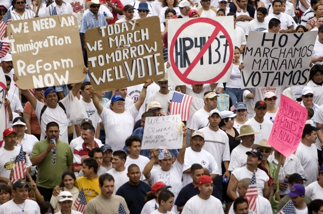 Demonstrators march along Third Ave during a pro-immigration march and rally on April 10, 2006 that took place in downtown Phoenix and ended at the state Capitol.
