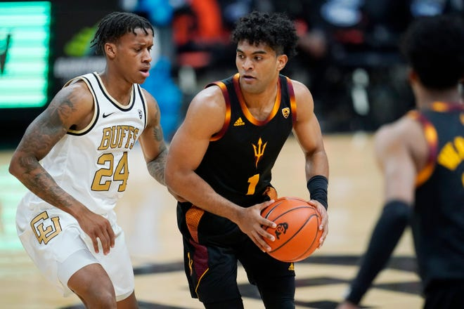 Arizona State guard Remy Martin, right, looks to drive the lane as Colorado guard Eli Parquet defends in the first half of an NCAA college basketball game Thursday, March 4, 2021, in Boulder, Colo. (AP Photo/David Zalubowski)