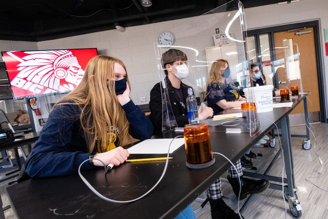 Students from Capac High School listen as a question is read during a Quiz Bowl match Thursday, March 4, 2021, at Port Huron High School.