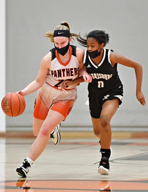 Central York's Sarah Berman, left, drives the ball down the court while Harrisburg's Joy Pagan defends during District III, Class 6-A girls' basketball quarterfinal action at Central York High School in Springettsbury Township, Thursday, March 4, 2021. Central York would win the game 66-41. Dawn J. Sagert photo