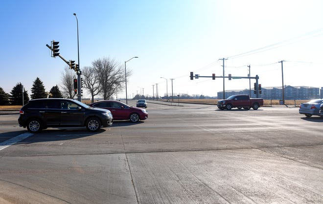 Cars pass through an intersection at 41st Street and Highway 11 on Friday, March 5, 2021, in Sioux Falls.