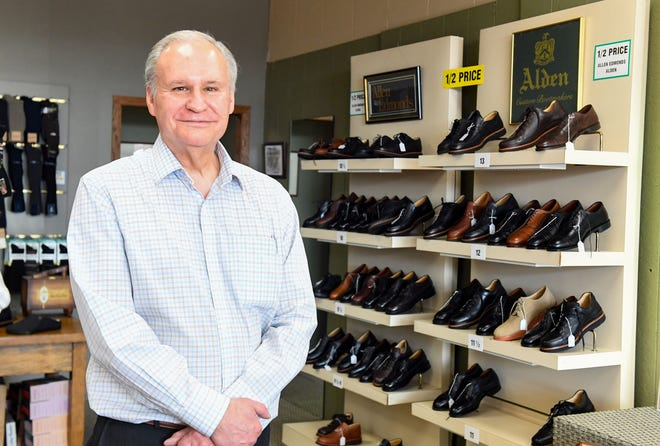 Owner Tom Coppock stands for a portrait on Friday, March 5, 2021, at Arthur Johnson Shoes in Sioux Falls.