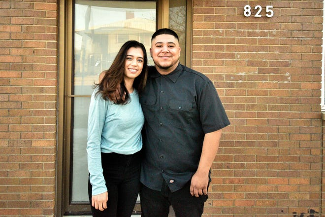 Kevin Valerio (left) and Samantha Olivares-Johnson outside their barber salon that is under construction.