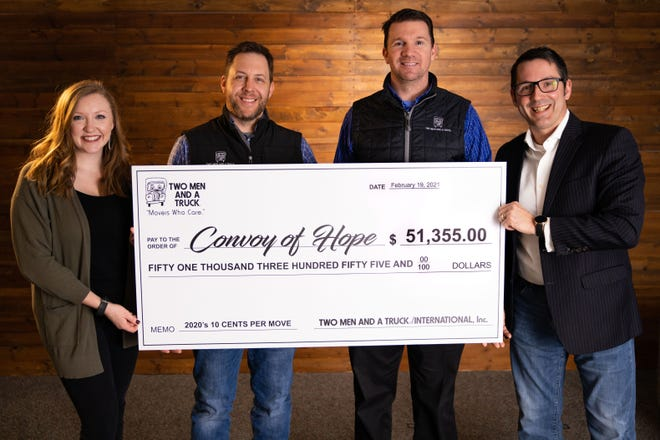 Two Men and A Truck donated $51,335 to Convoy of Hope to help people in communities nationwide hit by natural disasters, COVID or other devastation. Pictured (from left) are Sarah Spickard, Corporate Relations Project Manager at Convoy of Hope; Grant Hornbuckle, franchise owner of Springfield's and Branson's Two Men and a Truck; Clint Bergman, general manager of Springfield's Two Men and a Truck; and Eric Neubauer, Regional Director of Partner Engagement at Convoy of Hope.