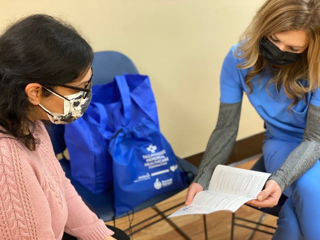 TMH registered dietitian consults with food insecure patient.
