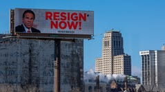 A billboard urging New York Governor Andrew Cuomo to resign is seen near downtown on March 2, 2021 in Albany, New York. The governor is facing calls to resign after three women have come forward accusing him of unwanted advances.