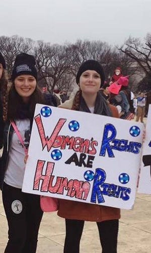 Katherine Barnes, left, and Charlotte Bennett - both students at Hamilton College at the time - at the Women's March on Washington in January 2017