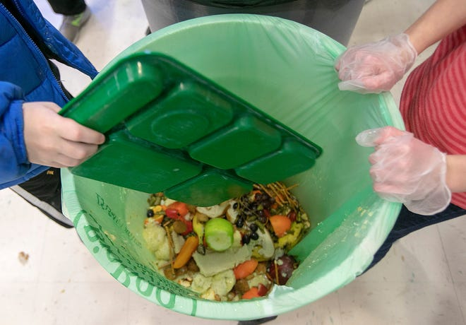 students discard food at the end of their lunch period as part of a lunch waste composting program at an elementary school in Connecticut. A United Nations report released on Thursday, March 4, 2021 estimates 17% of the food produced globally each year is wasted. That amounts to 931 million tons of food, or about double what researchers believed was being wasted a decade ago.