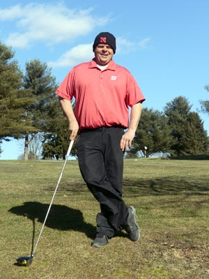 Mickey Ponsler stands in front of the 18th green at Jaycees Golf Course in Zanesville. Ponsler is now general manager at Jaycees after years of building race cars.