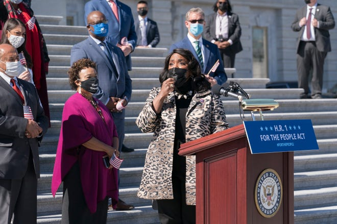 U.S. Alabama Rep. Terri Sewell recalled the work of the late U.S. Rep. John Lewis as Democrats gather for a press conference to urge passage of H.R. 1, the For the People Act of 2021, at the Capitol in Washington, Wednesday, March 3, 2021.  (AP Photo/J. Scott Applewhite)