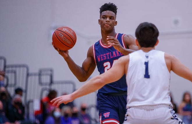 Westlake guard KJ Adams, looking to pass in an earlier game, had 19 points, nine rebounds and four blocked shots Friday as the Chaps beat San Antonio Clark to advance to the Class 6A state semifinals.